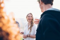 Friends enjoying roof party — Stock Photo
