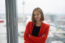 Business woman in front of office window — стоковое фото