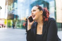 Businesswoman making smartphone call — Stock Photo