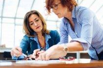 Two women solving problem — Stock Photo