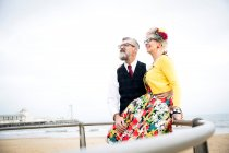 Couple at beach looking up — Stock Photo