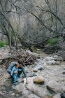 Father and baby boy investigating river — Stock Photo