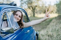 Woman looking out of car — Stock Photo