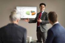 Businessman making office presentation — Stock Photo