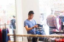 Young man clothes shopping — Stock Photo