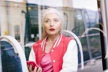 Mature woman in baseball jacket — Stock Photo