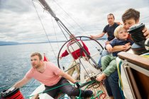 Four generation family on sailing boat — Stock Photo