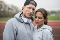 Couple at sports track — Stock Photo