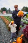 Boy and his father holding pumpkins — Stock Photo