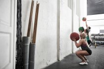 Friends throwing fitness balls — Stock Photo