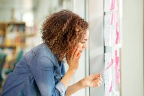 Female digital designer making call — Stock Photo