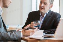 Businessmen working and making notes of discussion — Stock Photo