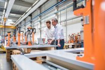 Two engineers in engineering factory — Stock Photo