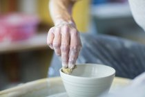 Senior woman in pottery workshop — Stock Photo