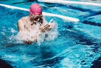 Swimmer splashing pool water on face — Stock Photo
