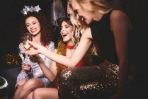 Women sitting together at party — Stock Photo