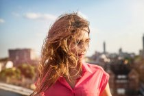 Young woman with long windswept hair — Stock Photo