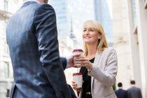 Businesswoman and businessman on coffee break — Stock Photo