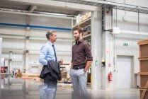 Supervisor and manager in distribution warehouse — Stock Photo
