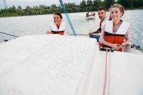 Three friends on sailing boat — Stock Photo