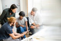 Designer team looking at digital tablet — Stock Photo