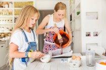 Girls preparing chocolate brownies — Stock Photo