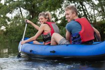 Couple kayaking in creek — Stock Photo