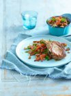 Plate of chops with vegetables — Stock Photo