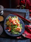 Plate of prawns and noodles — Stock Photo