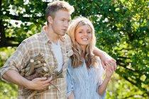 Couple gathering firewood — Stock Photo