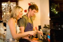 Mother and son cooking in kitchen — Stock Photo