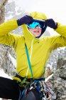 Woman adjusting ski goggles — Stock Photo