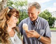 Man offering wife ice cream — Stock Photo
