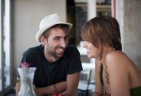 Couple sitting in restaurant — Stock Photo