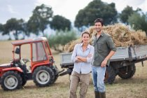 Farmers posing in front of truck — Stock Photo