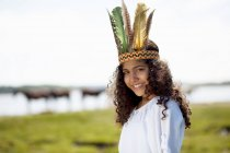 Girl wearing Native American costume — Stock Photo