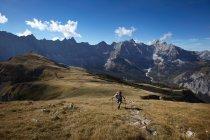 Man walking in mountains — Stock Photo