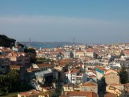 Coastal city with bridge on horizon — Stock Photo