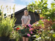 Female Buying Plants At Garden Center — Stock Photo