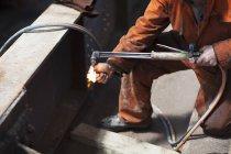 Welder lighting welding flame — Stock Photo