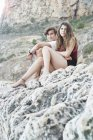 Portrait of young man and teenage sister on rocky beach, Javea, Spain — Stock Photo