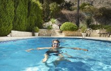Portrait of young man in swimming pool — Stock Photo
