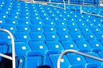 Empty blue seatings — Stock Photo