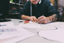Cropped shot of male metalworker designing in forge office — Stock Photo