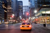 Yellow taxi cab at dusk — Stock Photo