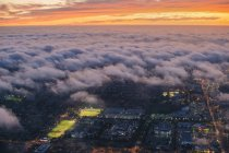 Aerial view of clouds and sunset light over Los Angeles — Stock Photo