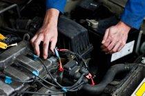 Cropped image of Mechanic fixing car engine — Stock Photo