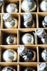 Silver christmas baubles in cardboard box — Stock Photo