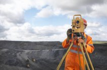 Coal Miner With Surveying Equipment — Stock Photo