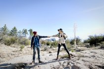 Young couple outdoors, hiking, holding hands — Stock Photo
